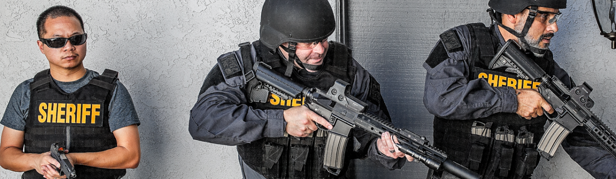 Law enforcement officers fully kitted in body armor